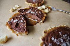 Dark choc, salted caramel and macadamia tarts