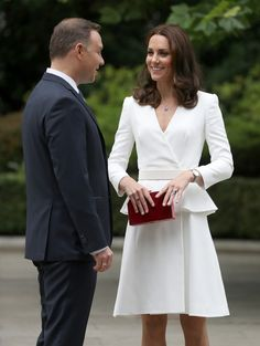 Kate Middleton Photos Photos - President Andrzej Duda with Catherine, Duchess of Cambridge as the Duchess and Prince William, Duke of Cambridge are shown around the gardens of the Presidential Palace on day 1 of their offical visit to Poland on July 17, 2017 in Warsaw, Poland. - The Duke And Duchess Of Cambridge Visit Poland - Day 1