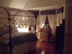 "My bedroom is complete, with Moses Eaton stencils I used for circa 1800's I made the cornices and for the curtains, I used the old ""ball"" curtains from Country Curtains.made the quilt,   Karen Comita-Morgan, Reading, Massachusetts"
