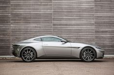 With the release of the latest James Bond film, we go to England to drive the three best Aston Martin sports cars associated with Britain's most debonair secret agent. Aston Martin Sports Car, Aston Martin Lagonda, Geometric Patterns, Martin O'malley, James Bond Cars, Hot Cars, Luxury Cars, Dream Cars, Super Cars
