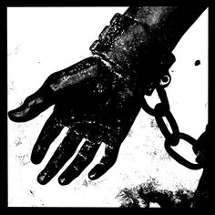 Bound +++ photograph by Daniela Faber +++ Grete Minde statue in Tangermünde, Germany +++ serf slave prisoner shackles chains iron