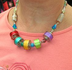 Necklace made from beads and threaded bobbins.  Saw at Paducah, Ky. Quilt Show
