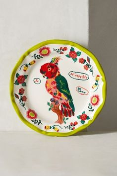 Nathalie Lete Dinner Plate - bright coloured parrot plate with yellow fluted edges and flowers