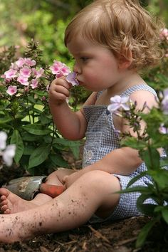 How precious is this little girl bonding with Mother Earth & her blooms. Perhaps she will make a fine gardener someday. (love the dirt on her legs-makes this picture perfect. :-)...bh