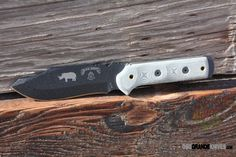 """TOPS BRM101 Black Rhino, Micarta Handle, PlainEdge. The TOPS Knives Black Rhino Knife features a 5.0"""" blade of 1095 High Carbon Alloy hardened to RC 58. OAL: 10.75"""", Blade Thickness: .25"""", Blade color: Tactical Black. http://www.osograndeknives.com/catalog/fixed-blade-tactical-knives/tops-brm101-black-rhino-micarta-handle-plainedge-6679.html"""