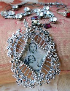'devotion' vintage assemblage necklace with prayer card image, rhinestones and garnets by The French Circus on Etsy