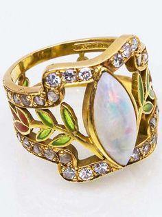 Ring, Masriera y Carreras, Barcelona, ca 1925...gold, enamel, opal and diamonds.