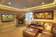 Denver basement finishing project with entertainment center and fireplace. | Yelp #basement #fireplace #ArchedRecess