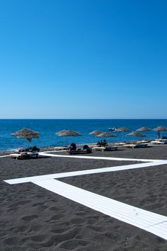 Black sand of Perivolos beach in Santorini - Been there once and wanna go back ! Amazing place