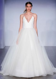 Jim Hjelm 8504 ivory Tulle bridal ball gown, lace bodice with halter neckline, T -strap back, sweep train.
