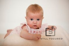 Norfolk photographer for babies and children bringing the studio to you.