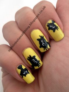 Yellow background and cute black cat nails.