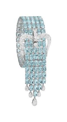 ADLER A Blue Topaz and Diamond Bracelet Designed as five lines of oval-cut blue topaz, enhanced by a pavé-set diamond buckle and fringe, mounted in 18K white gold, length 7 inches with 2 3/4 inch over hang.