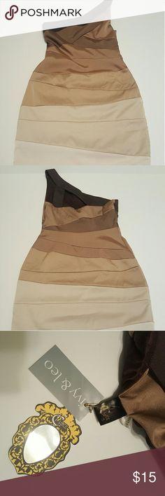 C-Luce Cold Shoulder Dress Cold shoulder bandage style dress. C-Luce BNWT Cream Tan and Gold colors Never worn! c-luce Dresses One Shoulder