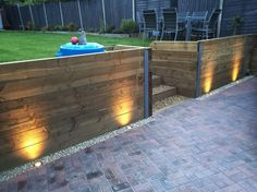 Finished retaining sleeper wall, steps, block paving driveway and exterior LED garden lighting                                                                                                                                                     More