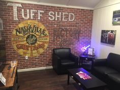 Personalize your man cave with a custom statement wall. Faux brick and antique paint turn this shed into a downtown loft themed hangout. Add neon, reclaimed wood, and leather chairs for the ultimate man cave style.