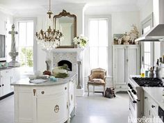 Designer Annie Brahler upgraded a vintage demilune chest by adding rear cabinets and a marble top to create the central island in her kitchen.
