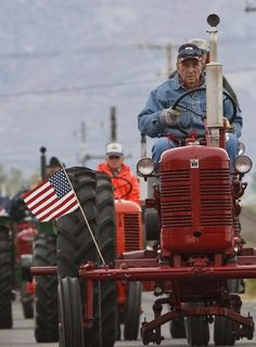Jay Riggs, of West Haven, drives an International Harvester as members of the Great Basin Antique Machinery Branch 95 parade their antique tractors throughout West Haven on their annual fun run Oct. 13, 2012 in West Haven. (Leah Hogsten  |  The Salt Lake Tribune)