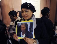 Hawa Bah, mother of Mohammed Bah, holds a photo of her son at a news conference in Albany, N.Y.