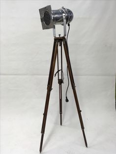 Vintage theatre-lamp on an old wooden tripod.