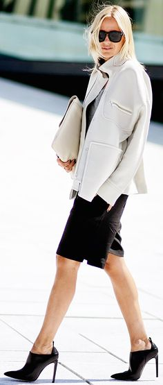Oversized clutch + tailored shorts + black heels