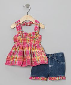 What a pretty pairing this halter top and matching shorts make! Little trendsetters will love heading to the park in this darling plaid ensemble. Ruffle accents and durable cotton denim are perfect for playing the day away.