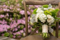 This sweet bouquet by @ecochicblossoms was a mix of elegant and rustic and a perfect adornment for this spring wedding...Tuscan chair from Party Suppliers.