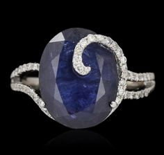 18KT White Gold 5.97ct Sapphire and Diamond Ring