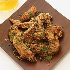 Ike's Vietnamese Fish Sauce Wings | Chef-owner Andy Ricker, who takes annual trips to Southeast Asia, first tried fish sauce wings at a roadside stand in Saigon seven years ago. He scribbled down his guess at the ingredients on a paper napkin, which he carried with him until Pok Pok opened.