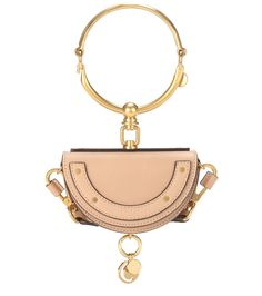 Chloé - Nile Minaudière Mini leather shoulder bag - Crafted in the original half-moon shape, this piece from Chloé features the Nile line's recognisable pronounced bracelet hardware in gold tone, which compliments the beige hue of the leather beautifully. Carry yours crossbody over flowy silk dresses this summer. seen @ www.mytheresa.com