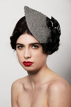 Silk silvery-grey headpiece, hand-beaded with silver balls, topped off in hand-cut black leather and patent vinyl leaves. For more inspiration visit www.weddingsite.co.uk