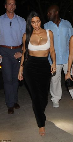 Va-voom! Kim Kardashian showed off her body when heading to a family dinner in Costa Rica on Friday evening. Here she has two guards behind her