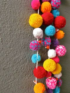 Garland Pick up some pompom balls of your favorite colour and pass a thick thread through it with the help of a needle. If you wish to keep a distance between a pair of balls, do that with the help of a glue gun else your can weave it just like a beaded necklace.