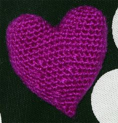 This little heart can be made with a small amount of any desired yarn.  Start making two circles:  In a magic ring, make 6 sc. Do not close...