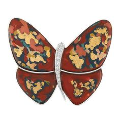 White Gold, Hardstone, Gold, Diamond and Mother-of-Pearl Butterfly Clip-Brooch, Van Cleef & Arpels   18 kt., the stylized butterfly centering a tapered diamond-set body, flanked by red, black, orange, green and mustard yellow hardstone wings, accented by scattered irregular patches of gold, within polished white gold, backed by mother-of-pearl, signed VCA, nos. CL 17257 & G.01/20. With signed box.