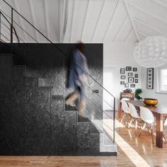 Inês Brandão installs black box of rooms inside converted barn home