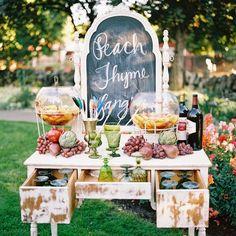 A vintage dresser is a pretty way to set up a serve yourself beverage bar. Credit: vintagewhitesblog.com #beveragebar #reception #vintageweddings