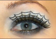 Use eyeliner to give yourself a spider web eye makeup look for Halloween.