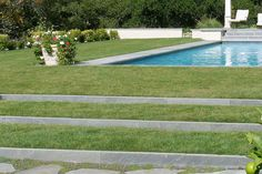 Though maybe not the easiest to maintain - but these lawn steps add more structure to a garden than any slope would do. Design by Thuilot Associates