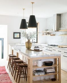 Light wood and white kitchen with open shelving and built in book shelves on end of island from Sam sacks via House and Home Kitchen Lighting Design, Kitchen Lighting Fixtures, Interior Design Kitchen, Kitchen Chandelier, Interior Ideas, Interior Decorating, Decorating Ideas, Farm Kitchen Ideas, Open Kitchen