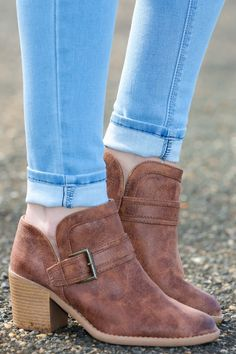 """Cute, comfy, and stylish, you know these are """"What You Need"""" to satisfy your craving for a pair of banging booties. Distressed low cut bootie with a decorative buckle strap.  Heel measures 2.5"""""""