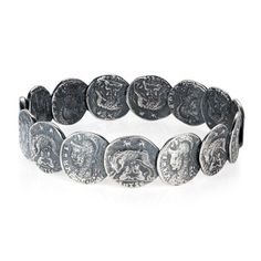 Joy Everley  Silver Roman Coin Bangle : A bangle of overlapping coin-shapes alternately depicting the goddess Roma on one side, Romulus and Remus on the other. This design is based on a cast made from an original Roman coin which is what gives it a worn and distinctively textured look.  The detailing has emphasised through a intentional darkening of the solid sterling silver through an oxidisation process.  The bangle has been designed in London and handcrafted using traditional jewellery…