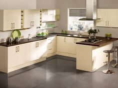 modern cream kitchen The Roma kitchen design from Tesco is a beautiful high gloss cream kitchen that offers a warm and modern colour for you.