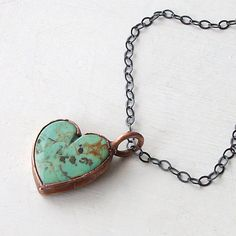 A rough-hewn heart of turquoise and copper.