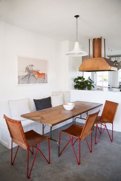 copper hood, leather dining chairs