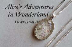 Alice in Wonderland 'We're All Mad Here' Necklace
