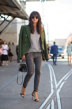 Skinny grey denim with heels and a green military-esque jacket.