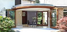The 6 door leaf Curved Folding Sliding Door system was crafted using Western Red Cedar.