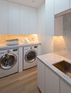 7 Laundry Room Design Ideas To Use In Your Home | Custom designed unit for housing the washer and dryer