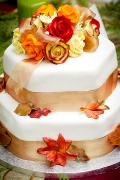 """At Juliette Weddings, LLC, we love autumn weddings! The vibrant colors, the crisp breeze in the air and the """"think outside the box"""" flavors for a wedding cake. This gorgeous design is a pumpkin spice cake on top and a layer of carrot cake on the bottom. We would suggest adding a third layer of traditional vanilla for your less adventurous wedding guests. Yum!"""
